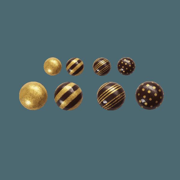 Décors en chocolat en forme de goutte et décorés couleur or