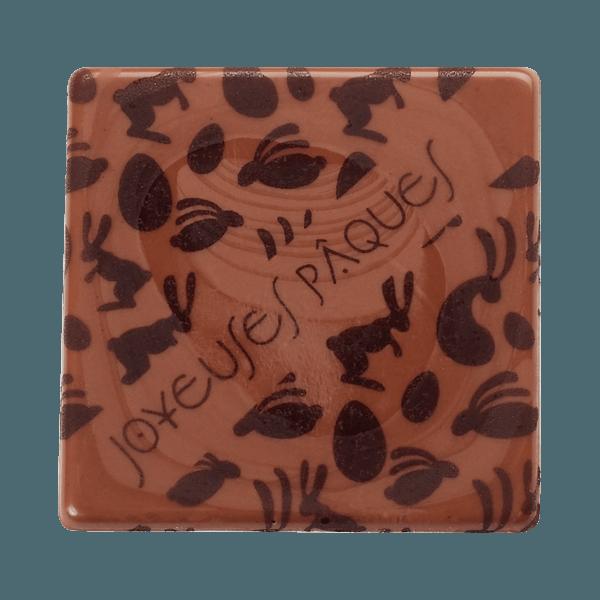 plaquette en chocolat joyeuses paques et dessins d'oeufs et de lapins